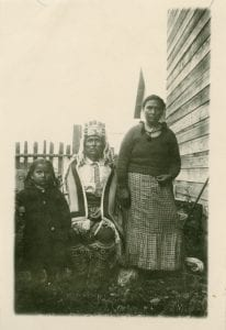 Billy Williams in full Haida regalia with his wife and daughter