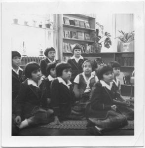 Story hour, Alberni Indian Residential School : Keith Johnson, vice-principal reading to a class