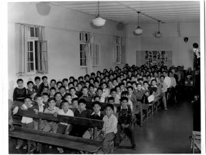 [Boys in the assembly hall of the Alberni Indian Residential School]