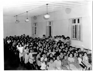 [Girls in the assembly hall of the Alberni Indian Residential School]