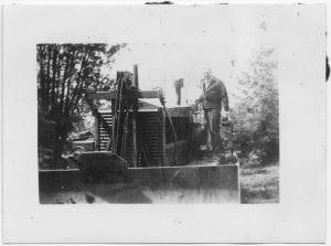 [Dr. J. Douglas Galbraith, Medical Superintendent, and a bulldozer, Bella Coola]