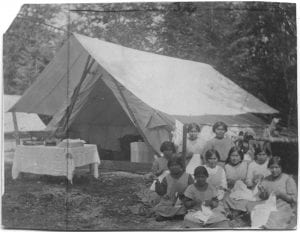 Girls of the Elizabeth Long Memorial Home sewing at camp