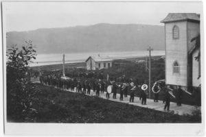 Band on boardwalk at Kitamaat: funeral procession