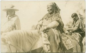Three First Nation on horseback